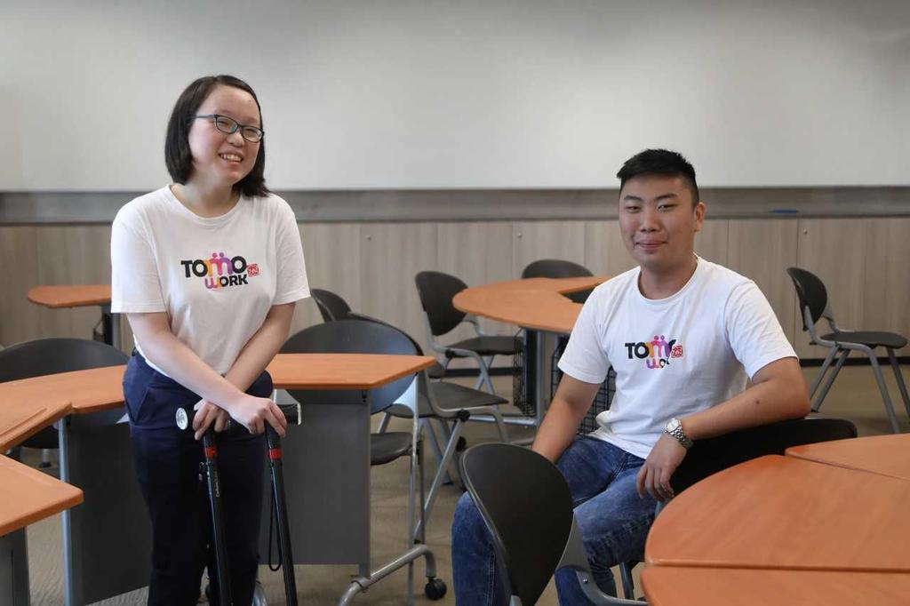 Temasek Polytechnic students Alina Seow (left), who has cerebral palsy, and Rayner Teo, who has a condition called Leber's hereditary optic neuropathy that affects his vision